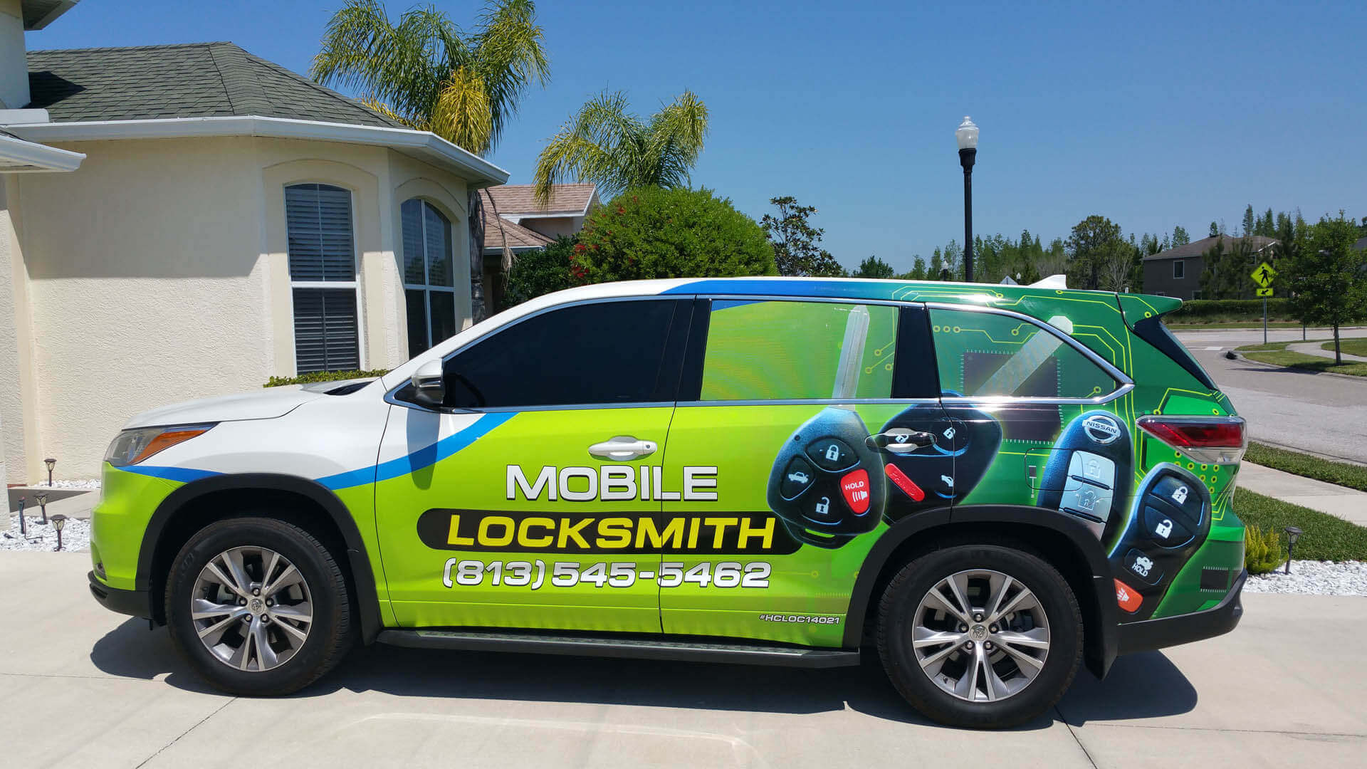 Cheap Lock & Key mobile locksmith in front a a home in Tampa, FL.