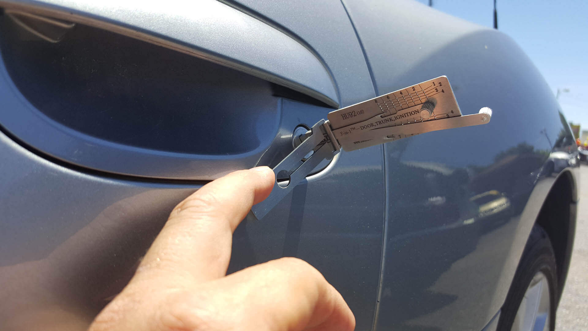 Locksmith making replacement keys for car.