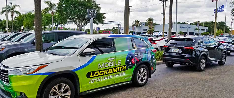 Mobile locksmith at a dealership in Tampa, FL.