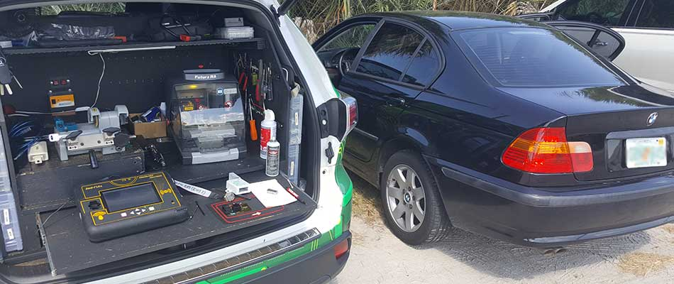 Mobile locksmith performing a repair on-site in Tampa, FL.