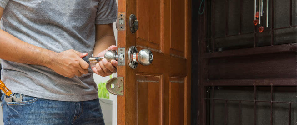 Locksmith working on a residential lockout in Tampa, FL