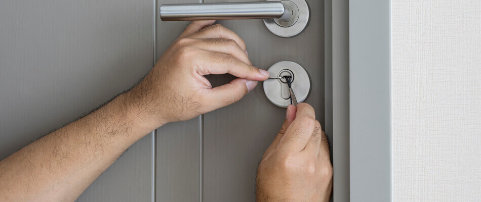 Cheap Lock & Key repairing a deadbolt lock in Brandon, FL.