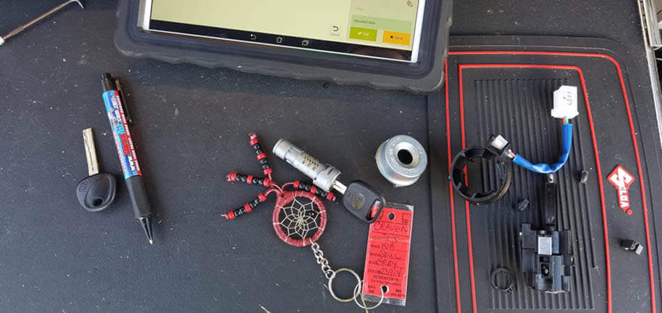Cheap Lock & Key repairing an ignition in Tampa, FL.