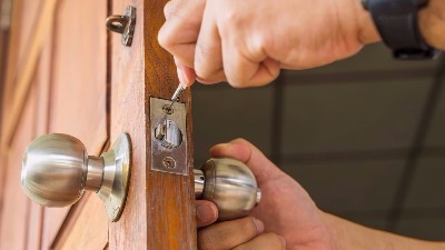 Repairing a lock at a home in Wesley Chapel, FL.